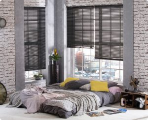 Venetian Blinds - Horizontal slatted blinds in metal or wood which can be adjusted to reduce glare and increase privacy. Fitted by Carolina